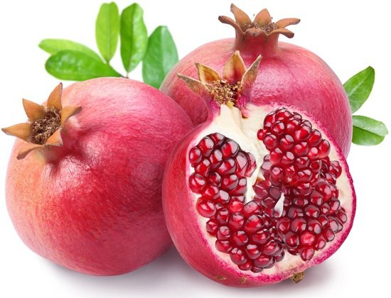 whole and sliced pomegranates
