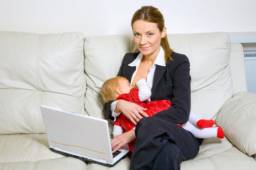 working mom breastfeeding on couch