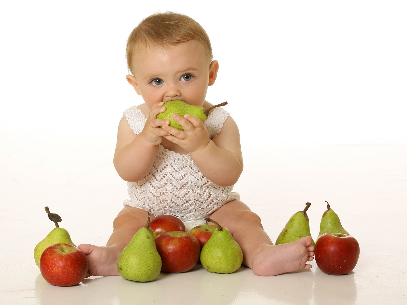 Cute baby eating fruits