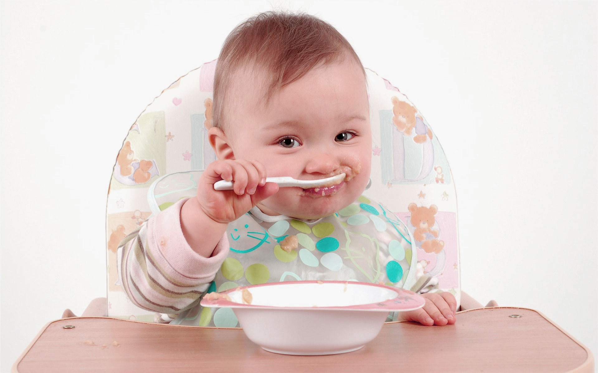 Cute baby self eating funny photo