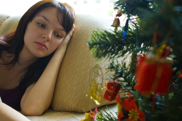 alone for holidays woman sad