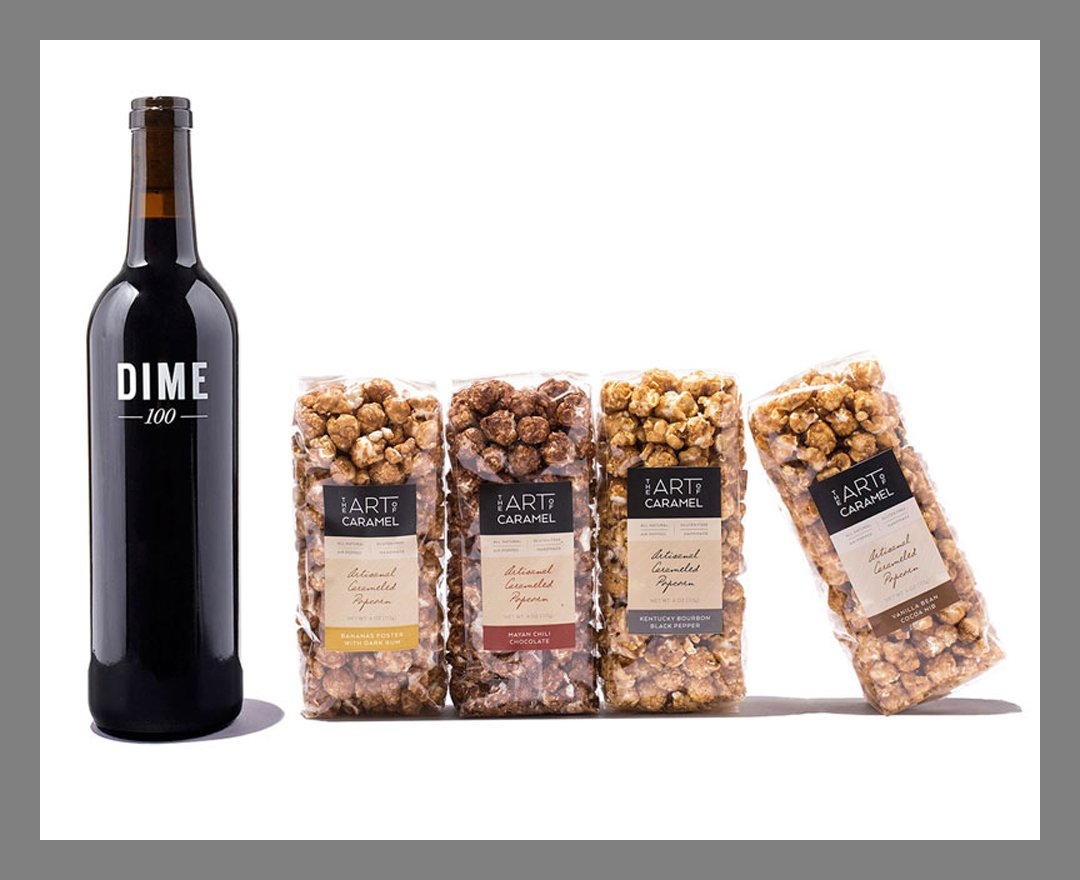 a bottle of wine and gourmet popcorns