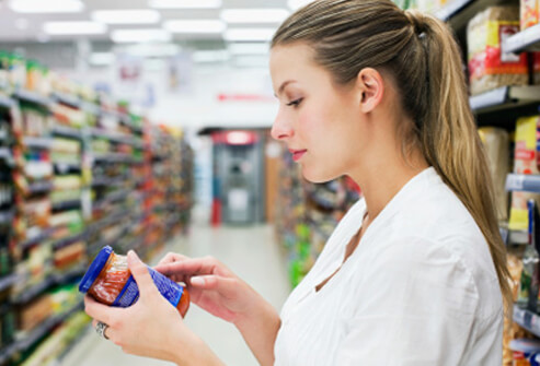 common food allergy triggers s1 photo of woman checking food label