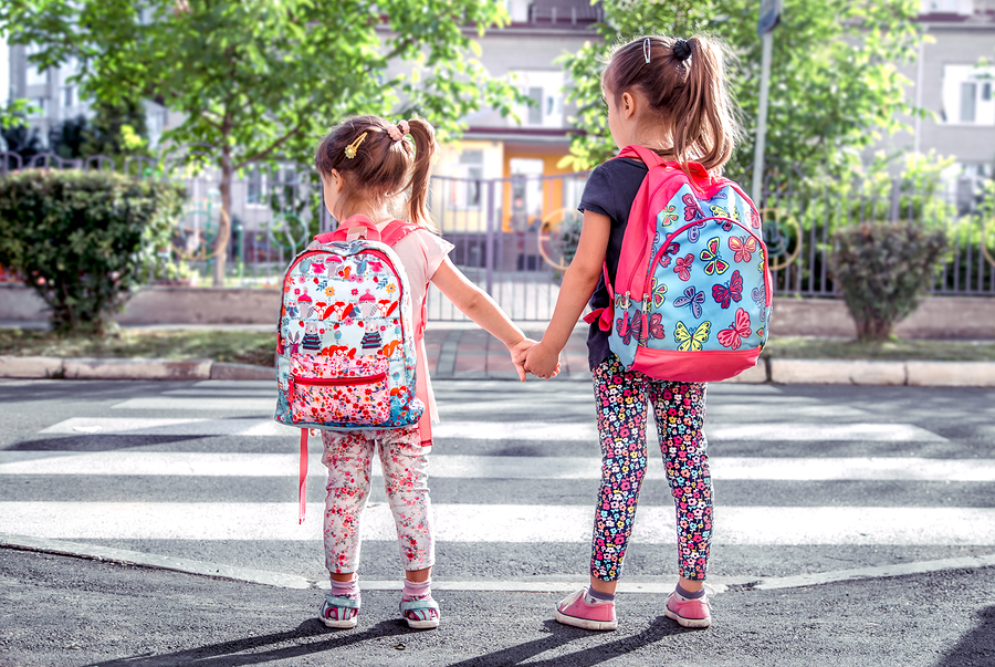 bigstock Children Go To School Happy S 256533346