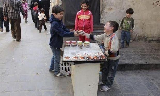 Τίποτε δε μπορεί να σταματήσει ένα παιδικό γέλιο. Ούτε καν ο πόλεμος! (φωτογραφία)