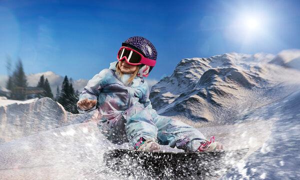 5χρονη κάνει snowboard και σημειώνει μοναδικό ρεκόρ με εντυπωσιακό άλμα. Δείτε την! (vid)